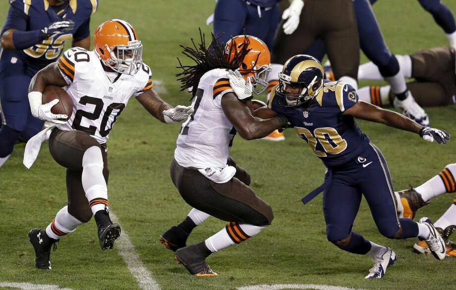 FILE - This Aug. 23, 2014, file photo shows Cleveland Browns running back Terrance West (20) running behind tight end MarQueis Gray in the second quarter of a preseason NFL football game against the St. Louis Rams in Cleveland. With starting running back Ben Tate expected to miss Sunday's, Sept. 14, 2014, game with a knee injury, the Browns will again turn to rookies West and Crowell this week against New Orleans. West rushed for 100 yards, 91 in the second half, and Isaiah Crowell had two touchdowns in their debuts last week against Pittsburgh. (AP Photo/Tony Dejak, File)