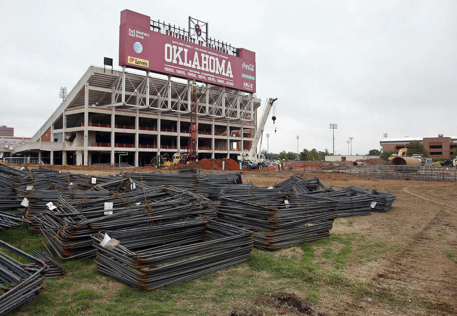 This Oct. 1, 2015 photo shows renovations under way at the University of Oklahoma's football stadium in Norman, Okla. Tumbling crude prices in oil-rich states are pinching off the largesse that helps universities when state budgets are strained. Oklahoma has scaled back a planned $370 million renovation to its football stadium. (AP Photo/Sue Ogrocki)