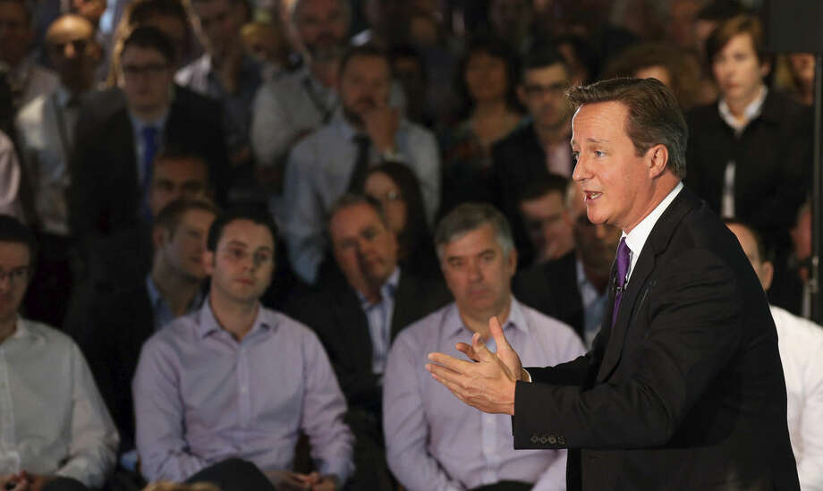 "Britain's Prime Minister, David Cameron, speaks during a visit to a financial office in Edinburgh, Wednesday Sept. 10, 2014, where he made an impassioned plea to keep Scotland part of the union, saying he would be ""heartbroken"" if the United Kingdom was torn apart. (AP Photo/PA, Andrew Milligan) UNITED KINGDOM OUT NO SALES NO ARCHIVE"