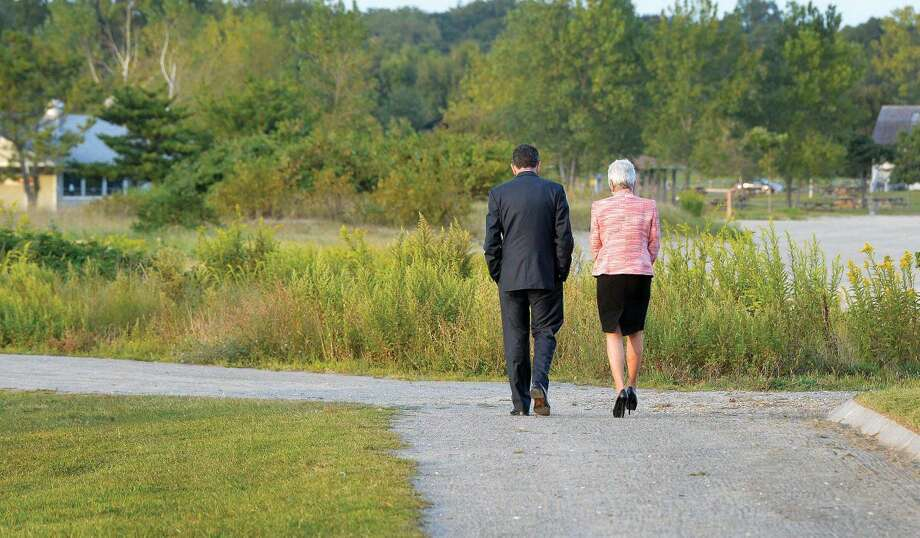 Hour Photo/Alex von Kleydorff. Governor Dan Malloy and Lt. Governor Nancy Wyman share a moment as they walk along a path after greeting all lthose who came to the Connecticut Remembers September 11th Memorial Ceremony at Sherwood Island state Park, Wednesday evening