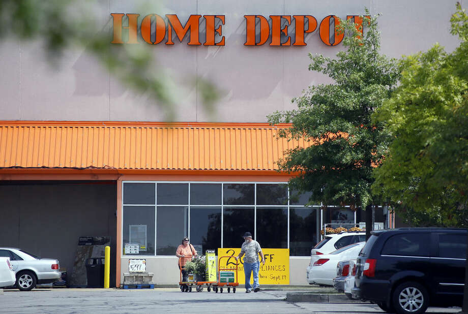 Customers push carts of goods from the Home Depot store in Cranberry, Pa., on Wednesday, Sept. 10, 2014. Home Depot's data breach could wind up being among the largest ever for a retailer, but that may not matter to its millions of customers. (AP Photo/Keith Srakocic)