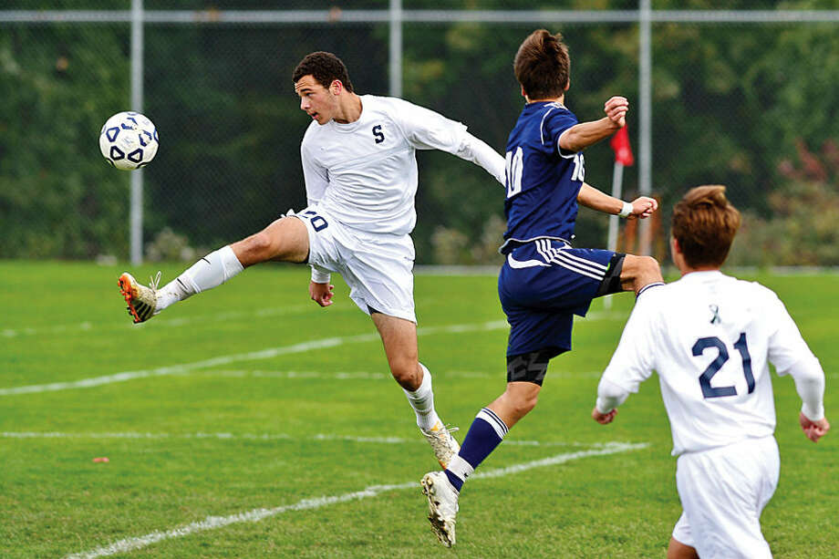 Hour photo / Erik Trautmann Staples High School # takes on Wilton in boys soccer Saturday in Westport.