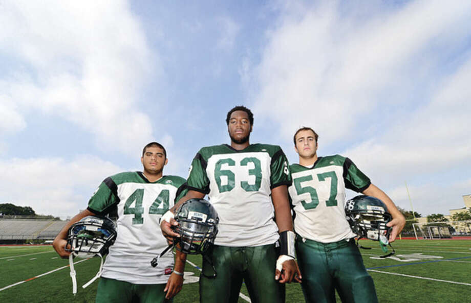 Hour photo/Erik TrautmannNorwalk High School football captains, from left, Ricky Mejia, Evan Adams and Billy Passero.