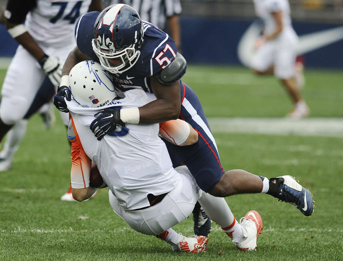 Connecticut linebacker Cole Ormsby (57) sacks Boise State quarterback Grant Hedrick (9), during the first half of an NCAA college football game at Rentschler Field, Saturday, Sept. 13, 2014, in East Hartford, Conn. (AP Photo/Jessica Hill)
