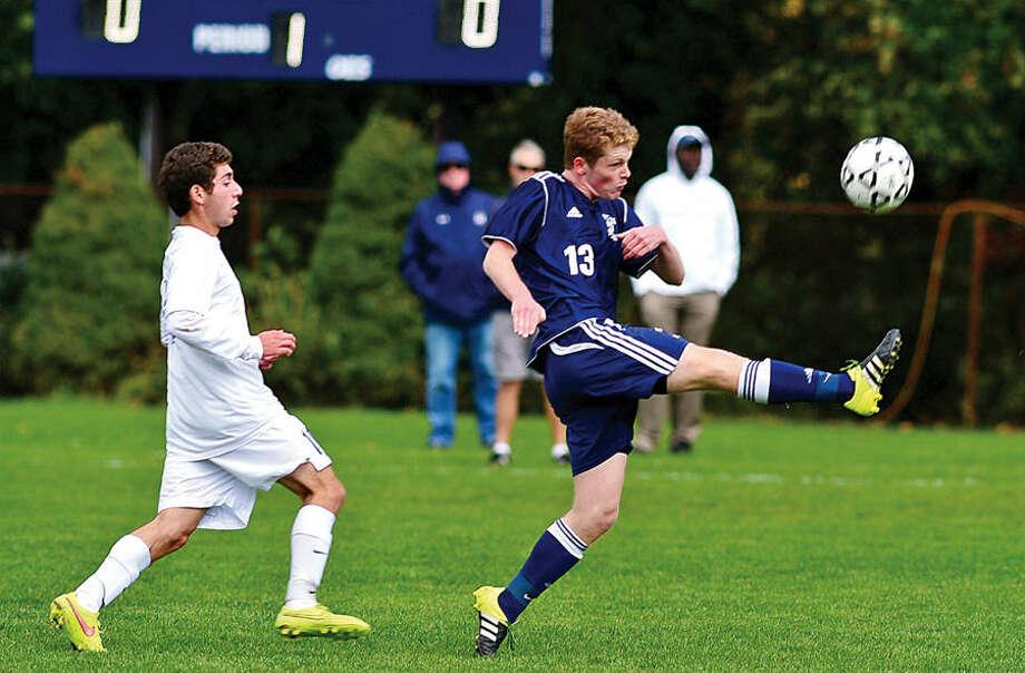 Hour photo / Erik Trautmann Staples High School # takes on Wilton in boys soccer Saturday in Westport.