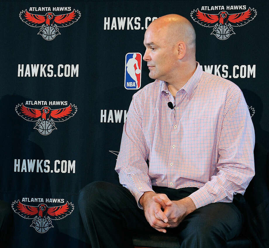 FILE - In this May 29, 2013, file photo, Atlanta Hawks general managerr Danny Ferry waits during a news conference in Atlanta. A double dose of racially inflammatory comments by the Atlanta Hawks' leadership has created a a crisis that threatens to resonate on the court and in the stands. This is a team that already ranked 28th out of 30 teams in attendance last season. (AP Photo/David Tulis, File)