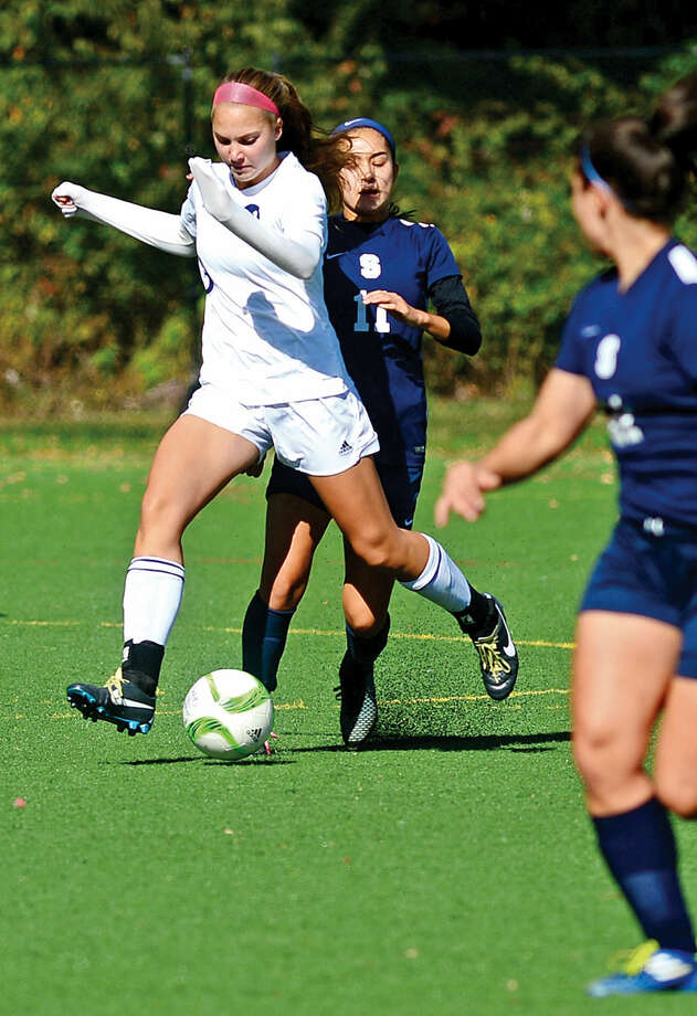 Hour photo / Erik Trautmann Staples High School girls soccer takes on Wilton Saturday.