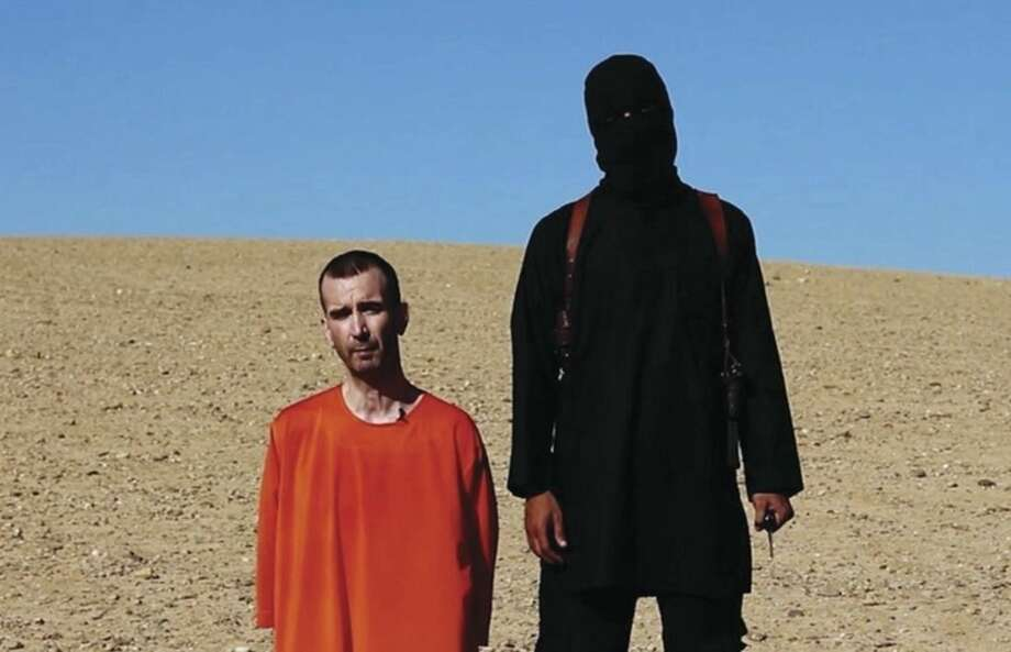 AP photoThis image made from video posted on the Internet by Islamic State militants and provided by the SITE Intelligence Group, a U.S. terrorism watchdog, on Saturday, purports to show British aid worker David Haines before he was beheaded. The video emerged hours after the family of Haines issued a public plea on Saturday urging his captors to contact them.