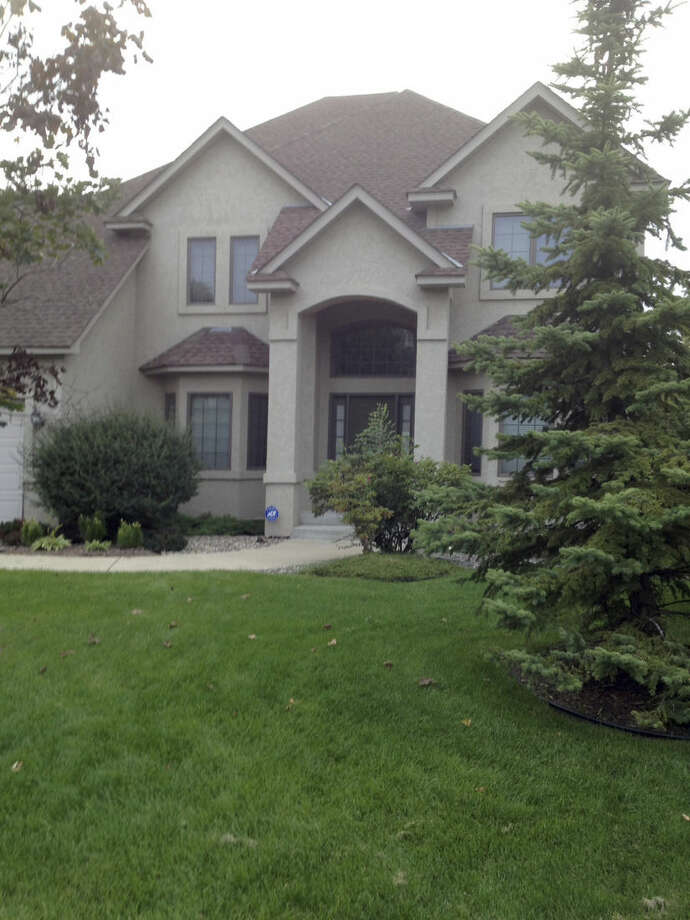 The home of running back Adrian Peterson is shown Saturday, Sept. 13, 2014, in Eden Prairie, Minn. Peterson was indicted in Texas for using a branch to spank one of his sons. He turned himself in early Saturday at a jail in Montgomery County and was processed and released according to a jail records official. (AP Photo/Jeff Baenen)