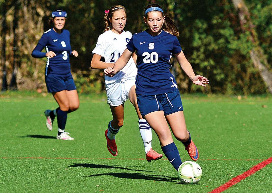 Hour photo / Erik Trautmann Staples High School girls soccer takes on Wilton Saturday.
