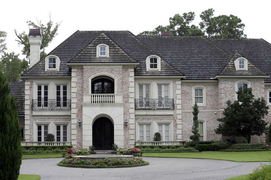 The Montgomery County home of running back Adrian Peterson is shown Saturday, Sept. 13, 2014, in Spring, Texas, north of Houston. Peterson was indicted in Texas for using a branch to spank one of his sons. He turned himself in early Saturday at a jail in Montgomery County and was processed and released according to a jail records official. (AP Photo/David J. Phillip)