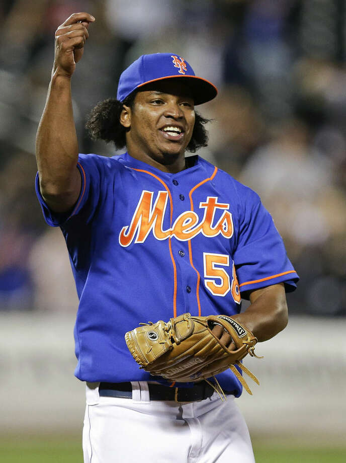 New York Mets relief pitcher Jenrry Mejia celebrates after the Mets defeated the Colorado Rockies 2-0 in a baseball game Wednesday, Sept. 10, 2014, in New York. (AP Photo/Frank Franklin II)