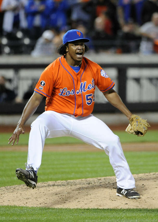 New York Mets relief pitcher Jenrry Mejia celebrates the Mets' 4-3 win over the Washington Nationals in a baseball game Friday, Sept. 12, 2014, in New York. (AP Photo/Kathy Kmonicek)