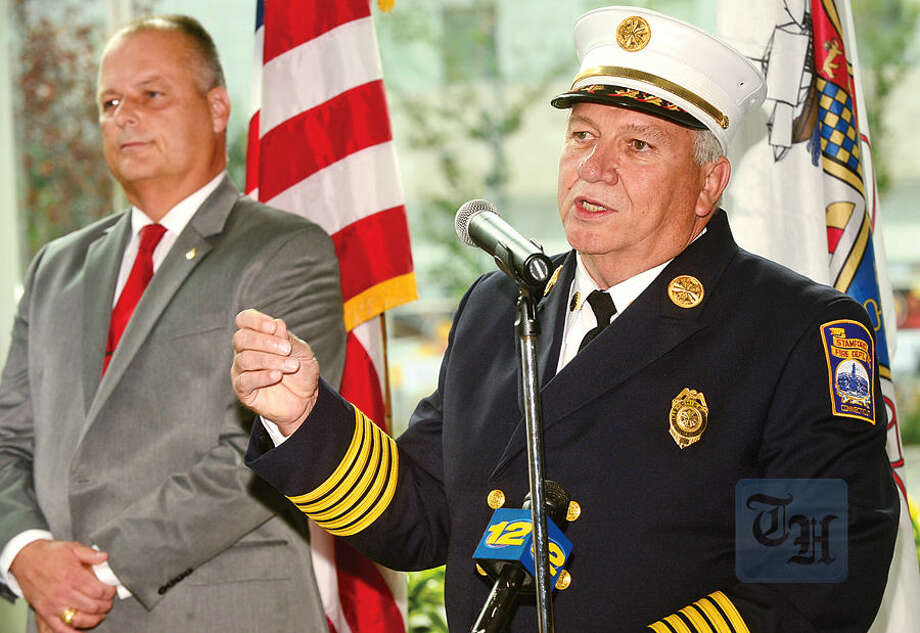 Hour photo / Erik Trautmann Chief of the Stamford Fire Department, Peter Brown, announces his retirement while Director of Public Safety, Ted Jankowski, looks on, during a press conference at the Stamford Government Center Wednesday.
