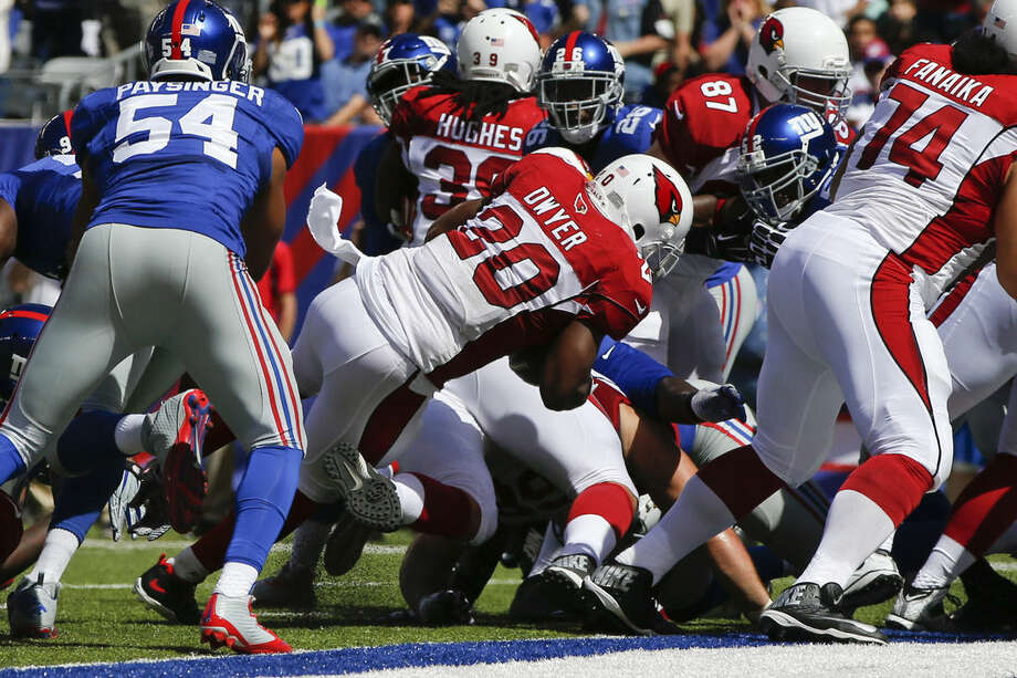 Arizona Cardinals running back Jonathan Dwyer (20) rushes for a touchdown during the first half of an NFL football game against the New York Giants, Sunday, Sept. 14, 2014, in East Rutherford, N.J. (AP Photo/Kathy Willens)
