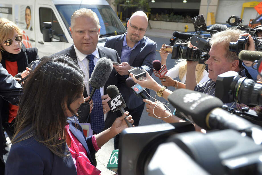 Mayor Rob Ford's brother, Doug Ford, arrives at Mount Sinai Hospital in Toronto on Wednesday, Sept. 17, 2014. Later in the day, Mayor Ford's doctor said he is suffering from a rare and difficult cancer that will require aggressive chemotherapy. (AP Photo/The Canadian Press, Nathan Denette)