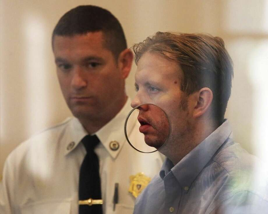 Michael McCarthy attends a hearing in Dorchester District Court, on Tuesday, Oct. 20, 2015, in Boston. McCarthy is charged with murder in the death of Bella Bond, 2, the girl dubbed Baby Doe. His girlfriend, Rachelle Bond, is charged with being an accessory after the fact in helping to dispose of the body of her daughter. (Wendy Maeda/The Boston Globe via AP, Pool)