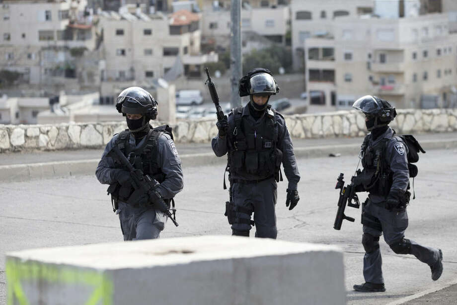 Israeli riot police officers operate in the Arab neighborhood of Issawiyeh in Jerusalem, Tuesday, Oct. 20, 2015. U.N. Secretary-General Ban Ki-moon will make a surprise visit to Israel and the Palestinian territories on Tuesday, in a high-profile gambit to bring an end to the monthlong wave of violence that has plagued the region. (AP Photo/Ariel Schalit)