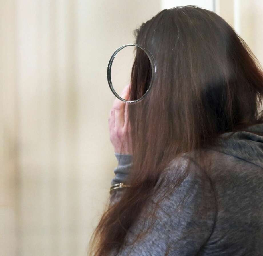 Rachelle Bond attends a hearing in Dorchester District Court, on Tuesday, Oct. 20, 2015, in Boston. Bond is charged with being an accessory after the fact in helping to dispose of the body of her daughter, Bella, the girl dubbed Baby Doe. Her boyfriend, Michael McCarthy is charged with murder. (Wendy Maeda/The Boston Globe via AP, Pool)