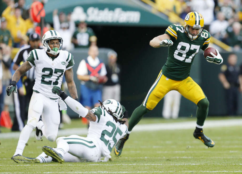 Green Bay Packers' Jordy Nelson gets away from New York Jets' Calvin Pryor (25) and Dee Milliner for an 80-yard touchdown catch during the second half of an NFL football game Sunday, Sept. 14, 2014, in Green Bay, Wis. (AP Photo/Mike Roemer)