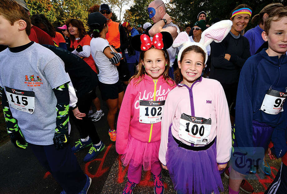 Hour photo / Erik Trautmann Catie Leddy and Eva Cagnassola get ready for the 4th Annual Christ and Holy Trinity Church's Ghost & Goblin 5K Walk/Run and Kids Fun Run at Sherwood Island State Park in Westport Saturday morning.