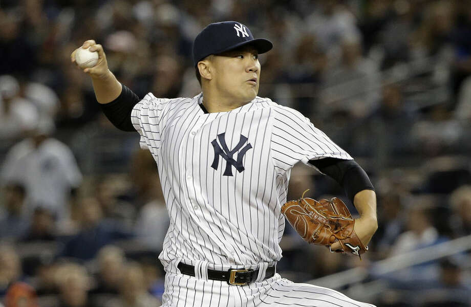 FILE - In this Tuesday, Oct. 6, 2015 file photo, New York Yankees pitcher Masahiro Tanaka delivers against the Houston Astros during the first inning of the American League wild card baseball game in New York. Yankees pitcher Masahiro Tanaka has undergone arthroscopic surgery to remove a bone spur from his right elbow, Tuesday, Oct. 20, 2015. (AP Photo/Julie Jacobson, File)