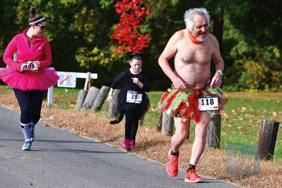 Hour photo / Erik Trautmann Charlie Merlis, right, takes part in the 4th Annual Christ and Holy Trinity Church's Ghost & Goblin 5K Walk/Run and Kids Fun Run at Sherwood Island State Park in Westport Saturday morning.