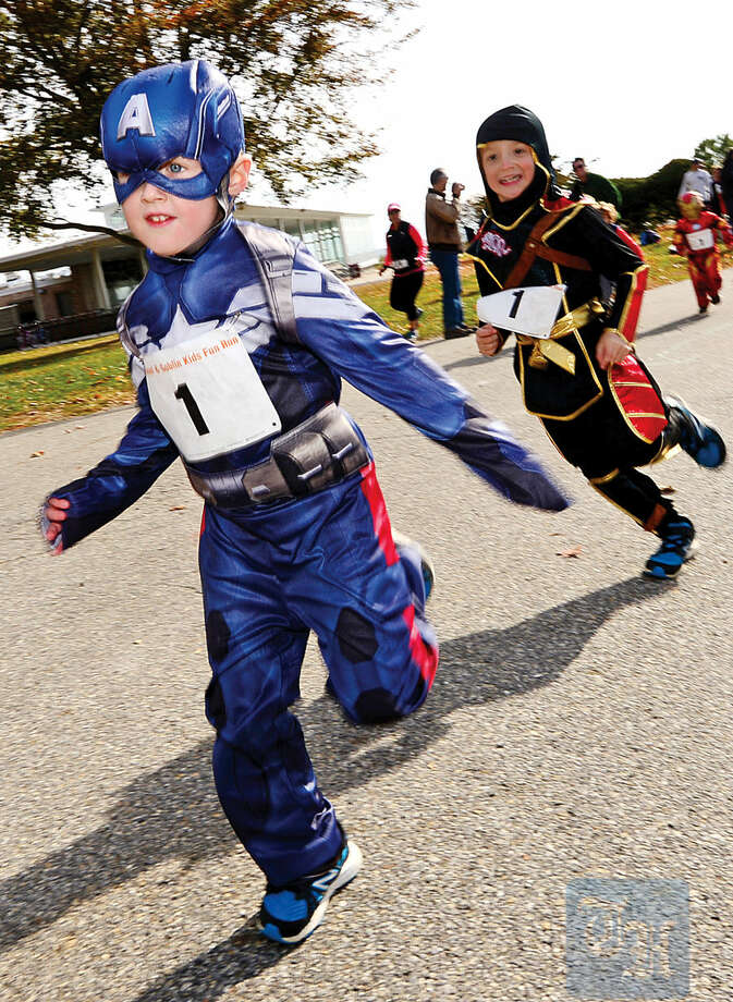 Hour photo / Erik Trautmann Thomas Luther, 4, takes part in the 4th Annual Christ and Holy Trinity Church's Ghost & Goblin 5K Walk/Run and Kids Fun Run at Sherwood Island State Park in Westport Saturday morning.