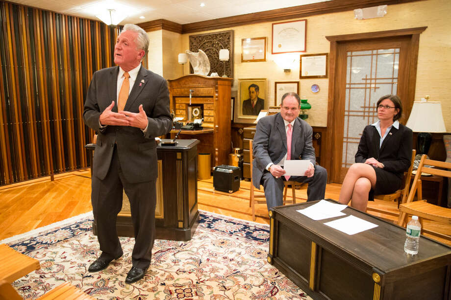 """Hour photo/Chris Palermo Norwalk Mayor Harry Rilling speaks alongside his runningmate Kelly Straniti and mediator Winthrop Baum at the """"Meet the Candidates"""" event hosted by the East Norwalk Business Association at 25 Van Zant St. Tuesday night."""