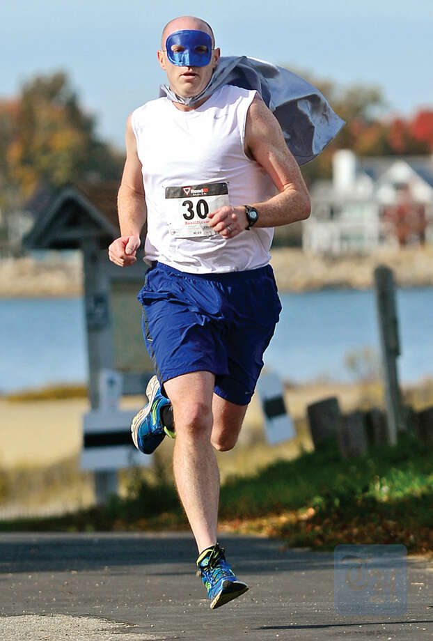 Hour photo / Erik Trautmann Matt Cotter wins the 4th Annual Christ and Holy Trinity Church's Ghost & Goblin 5K Run at Sherwood Island State Park in Westport Saturday morning.