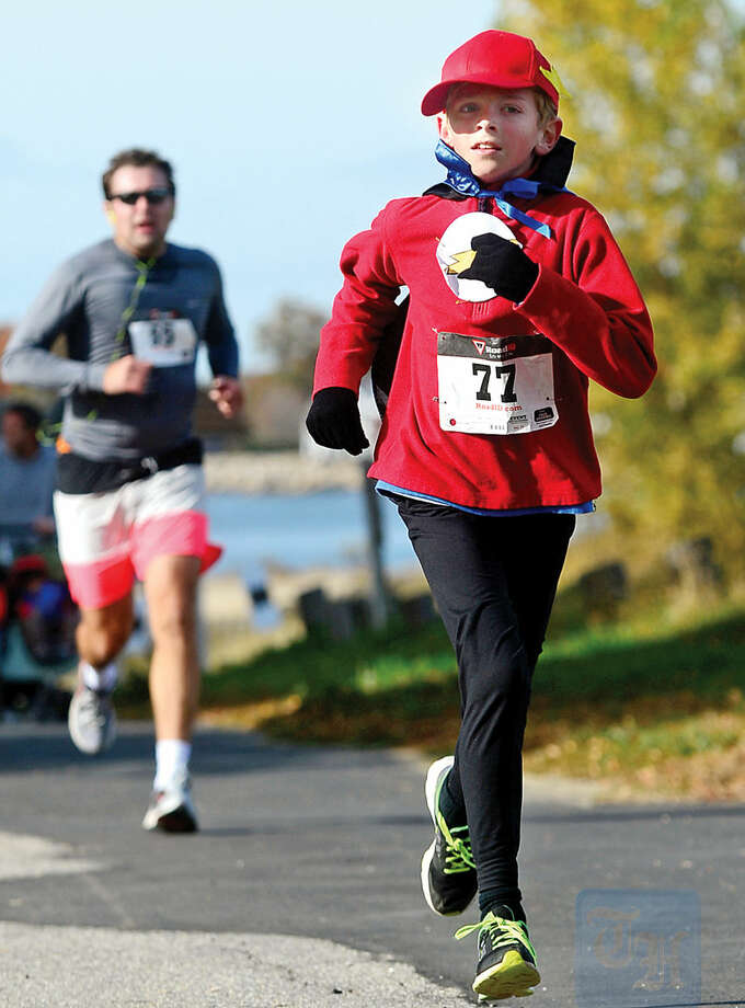 Hour photo / Erik Trautmann Aidan McCarthy, 9, takes part in the 4th Annual Christ and Holy Trinity Church's Ghost & Goblin 5K Walk/Run and Kids Fun Run at Sherwood Island State Park in Westport Saturday morning.