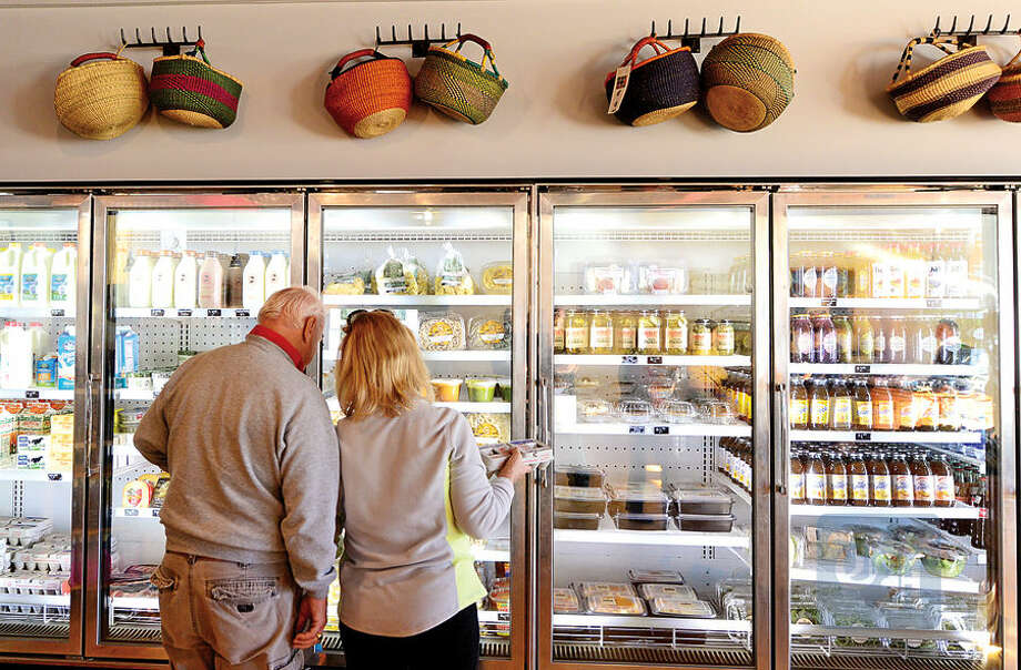 Hour photo / Erik Trautmann Co owners Bob Kunkel and Ernie Marsan have renovated the old Market Basket building on Cove Ave and opened as Harbor Harvest on Friday specializing in fresh local products.