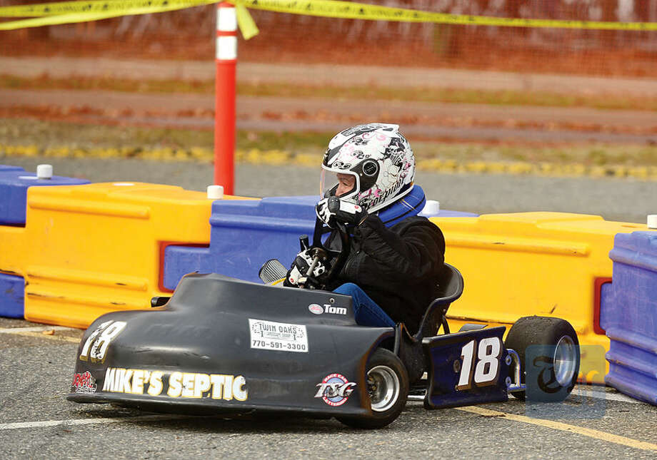 Hour photo / Erik Trautmann Councilwoman Michelle Magglio races in the inaugural Norwalk Karting Association Mayor's Cup Saturday at Calf Pasture Beach.