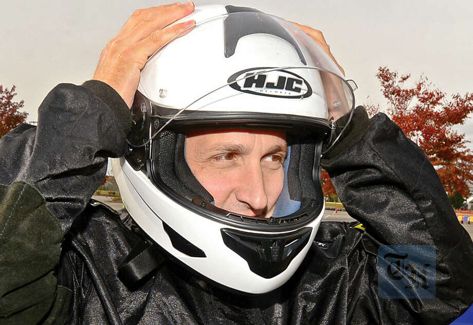 Hour photo / Erik Trautmann State Senator Bob Duff readies to race in the inaugural Norwalk Karting Association Mayor's Cup Saturday at Calf Pasture Beach.