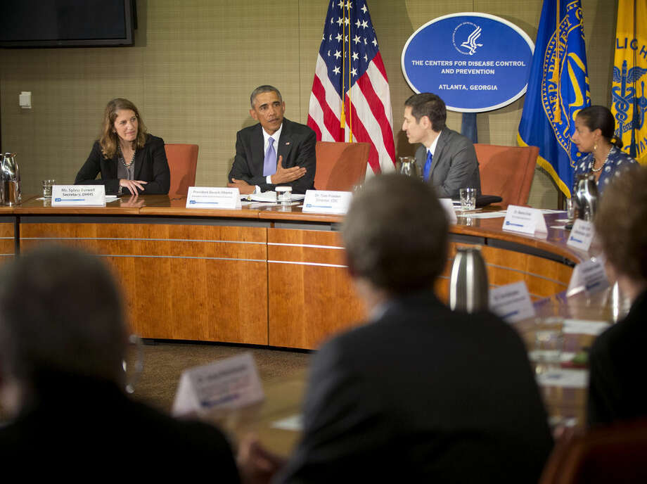 President Barack Obama, center, and from left, Secretary of Health and Human Services Sylvia Mathews Burwell, CDC Director Dr. Thomas Frieden, and National Security Adviser Susan Rice, during a briefing at the Centers for Disease Control and Prevention (CDC) in Atlanta, Tuesday, Sept. 16, 2014. Obama traveled to the CDC, to address the Ebola crisis and announced that he is sending 3,000 American troops to West Africa nations fight the spread of the Ebola epidemic. Obama (AP Photo/Pablo Martinez Monsivais)