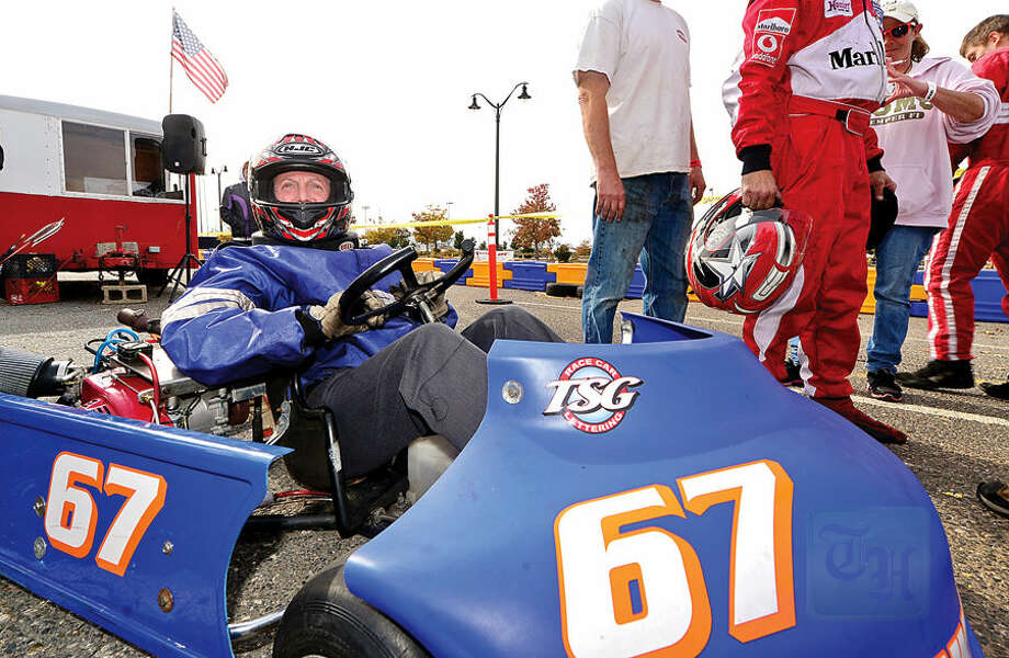 Hour photo / Erik Trautmann Norwalk Mayor Harry Rilling gets reday to race in his inaugural Norwalk Karting Association Mayor's Cup Saturday at Calf Pasture Beach.