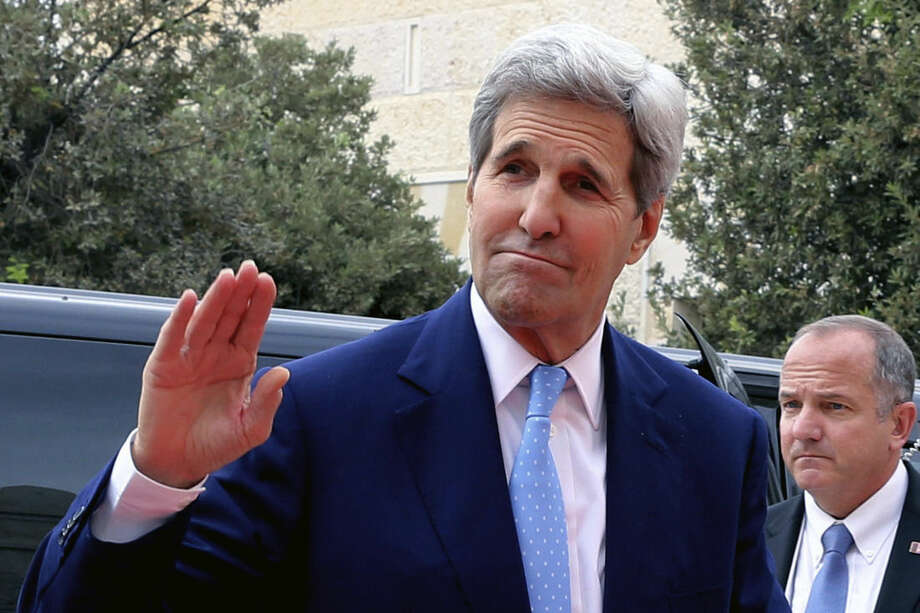 U.S. Secretary of State John Kerry arrives at the Royal Palace to meet Jordanian King Abdullah II, in Amman Jordan, Saturday, Oct. 24 2015. Kerry said Saturday that Israel and Jordan have agreed on steps aimed at reducing tensions at a holy site in Jerusalem that have fanned Israeli-Palestinian violence. (AP Photo/Raad Adayleh)