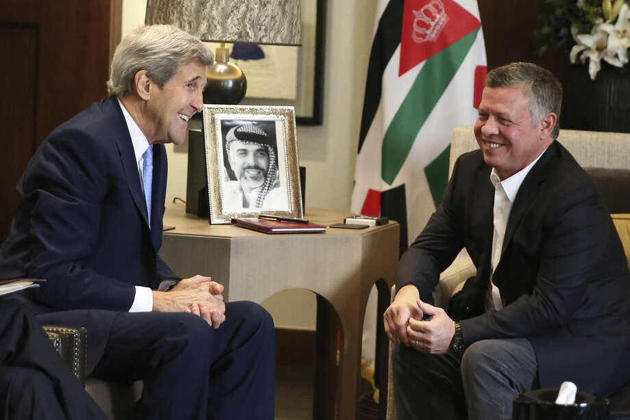 Jordanian King Abdullah II, right, meets with U.S. Secretary of State John Kerry at the Royal Palace in Amman Jordan, Saturday, Oct. 24 2015. Kerry said Saturday that Israel and Jordan have agreed on steps aimed at reducing tensions at a holy site in Jerusalem that have fanned Israeli-Palestinian violence. (AP Photo/Raad Adayleh)