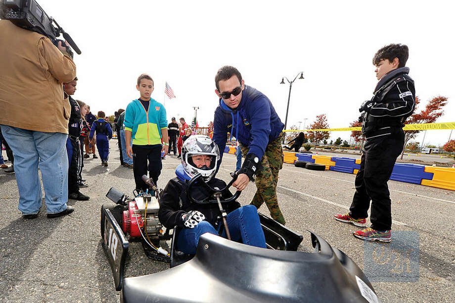 Hour photo / Erik Trautmann Councilwoman Michelle Magglio, gets ready to race in the inaugural Norwalk Karting Association Mayor's Cup Saturday at Calf Pasture Beach.