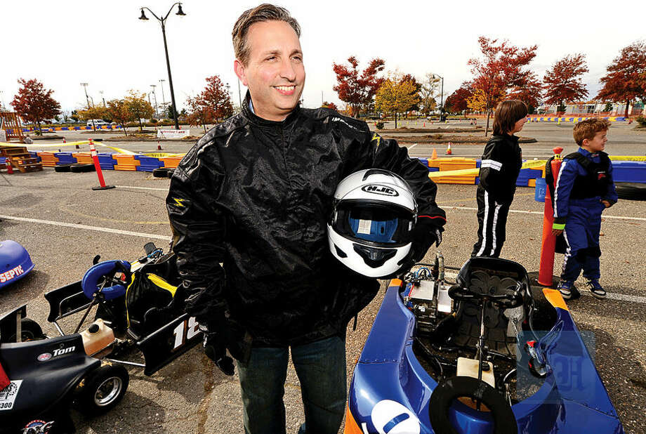 Hour photo / Erik Trautmann State Senator Bob Duff gets ready to race in the inaugural Norwalk Karting Association Mayor's Cup Saturday at Calf Pasture Beach.