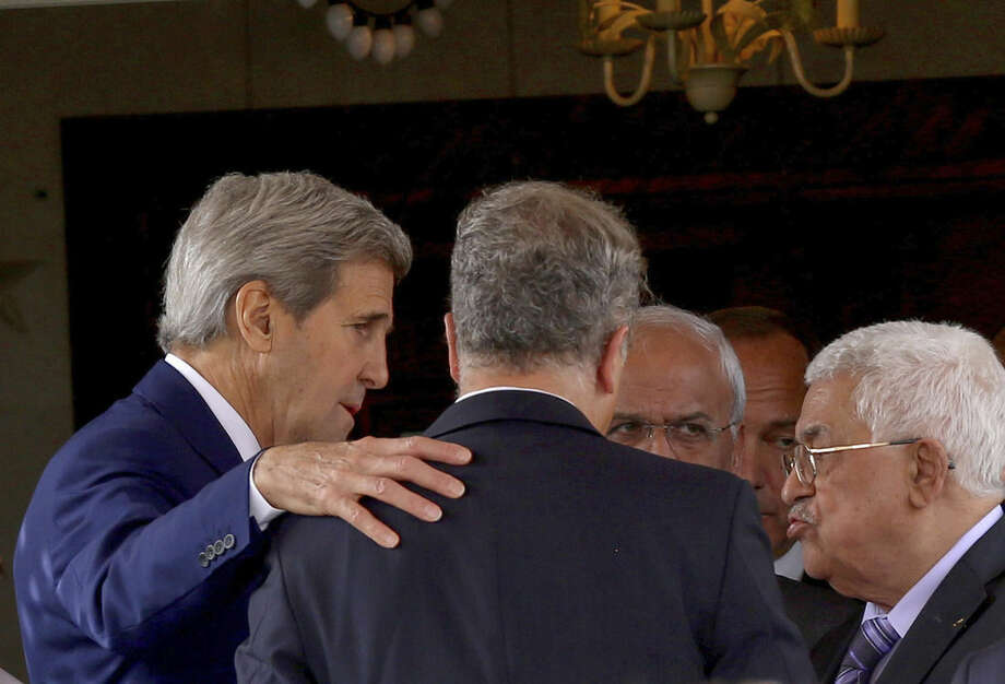 "U.S. Secretary of State John Kerry, left, speaks with Palestinian President Mahmoud Abbas, right, after their meeting at Abbas' residence in Amman, Jordan, Saturday, Oct. 24, 2015. Kerry said Saturday that Israel and Jordan have agreed on steps aimed at reducing tensions at a holy site in Jerusalem that have fanned Israeli-Palestinian violence. ""All the violence and the incitement to violence must stop. Leaders must lead,"" Kerry told reporters in the Jordanian capital after meeting with King Abdullah II and Abbas. (AP Photo/Raad Adayleh)"