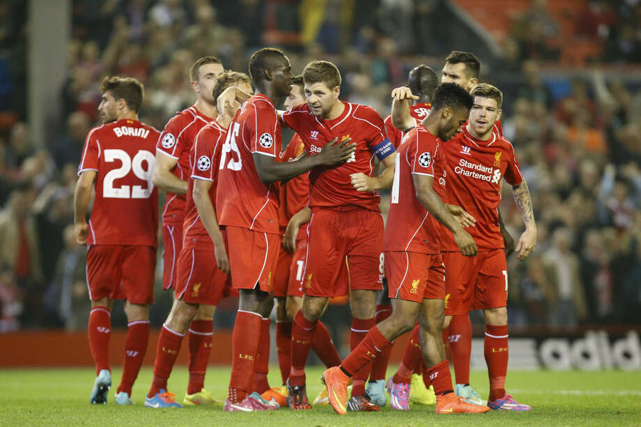 Liverpool's Steven Gerrard, center, celebrates with teammates after scoring against Ludogorets during the Champions League Group B soccer match between Liverpool and Ludogorets at Anfield Stadium in Liverpool, England, Tuesday, Oct. 16, 2014. (AP Photo/Jon Super)