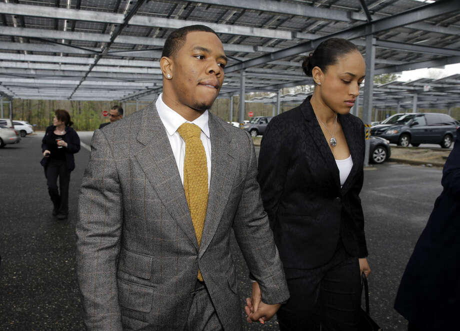 FILE - In this May 1, 2014, file photo, Baltimore Ravens football player Ray Rice holds hands with his wife, Janay, as they arrive at Atlantic County Criminal Courthouse in Mays Landing, N.J. The offender-rehabilitation program that former Raven Rice entered after knocking Janay unconscious in an Atlantic City elevator is rarely used in domestic assault cases. (AP Photo/Mel Evans, File)