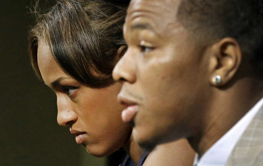 FILE - In this May 23, 2014, file photo, Janay Rice, left, looks on as her husband, Baltimore Ravens running back Ray Rice, speaks to the media during a news conference in Owings Mills, Md. By the time the typical player signs an NFL contract, around 100 scouts, coaches and general managers have pored over his history. Very little in the portfolios collected on Ray Rice or Adrian Peterson foreshadowed the issues they're dealing with now. (AP Photo/Patrick Semansky, File)
