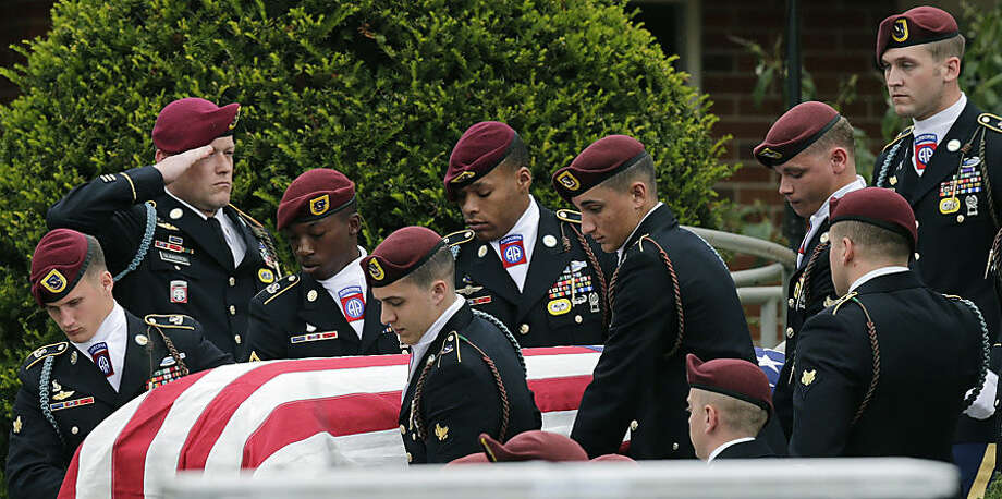 Paratroopers from the 82nd Airborne Division carry the casket of Army Spc. Brian Arsenault from the St. Rose of Lima Church during his funeral in Northborough, Mass., Tuesday, Sept. 16, 2014. Arsenault, a paratrooper with the 82nd Airborne Division, died earlier this month from injuries he suffered during a firefight between his unit and enemy forces in Afghanistan. (AP Photo/Charles Krupa)