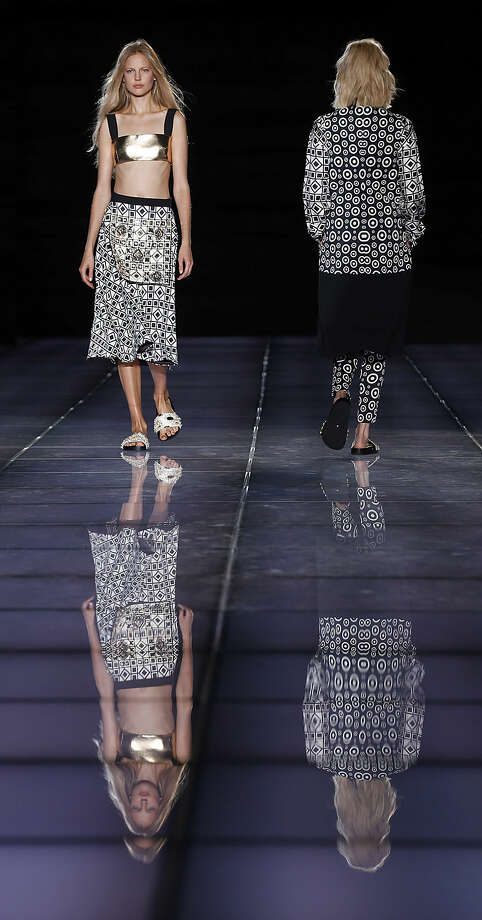 Models wear creations for Fausto Puglisi women's spring-summer 2015 collection, part of the Milan Fashion Week, unveiled in Milan, Italy, Wednesday, Sept. 17, 2014. (AP Photo/Luca Bruno)