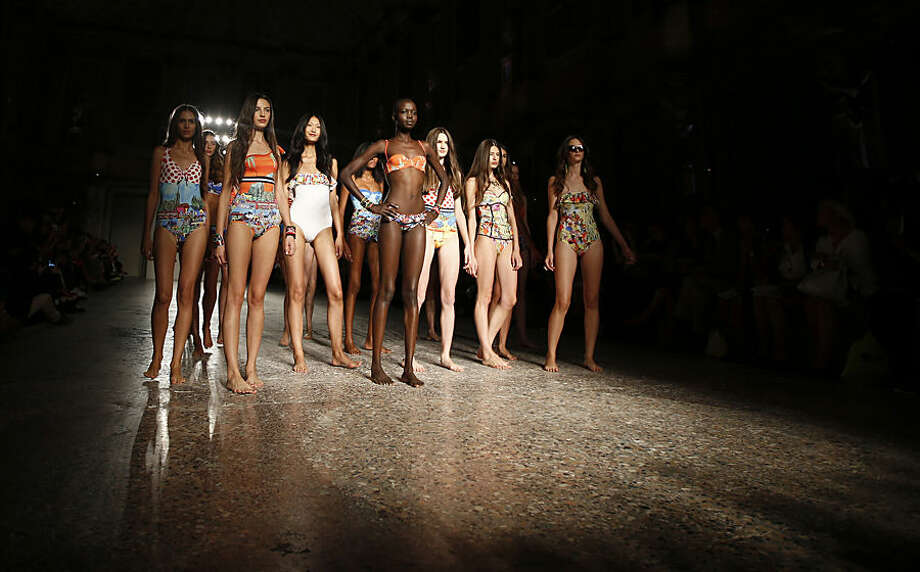 Models wear creations for Stella Jean women's spring-summer 2015 collection, part of the Milan Fashion Week, unveiled in Milan, Italy, Wednesday, Sept. 17, 2014. (AP Photo/Luca Bruno)