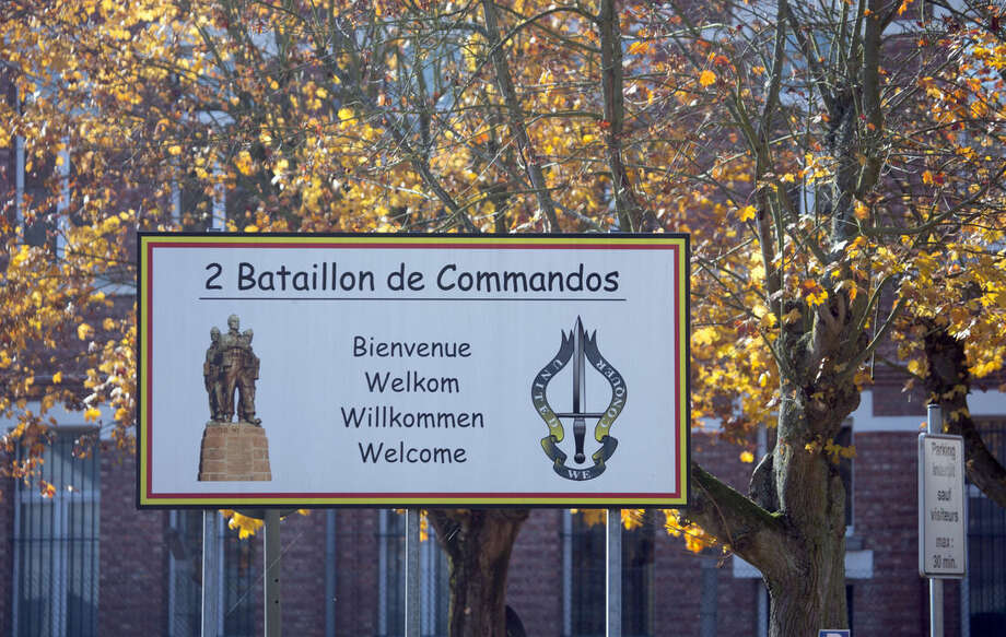A sign for the 2nd Battalion Commando's outside a military barracks in Flawinne, Belgium on Monday, Oct. 26, 2015. Belgian media are reporting a car has attempted to crash through the gates of an army barracks and that shots have been fired. (AP Photo/Virginia Mayo)
