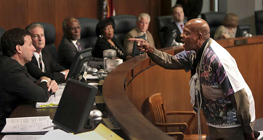 St. Louis activist Anthony Shahid confronts councilman Steve Stenger during the St. Louis County Council on Tuesday, Sept. 16, 2014, in Clayton, Mo. Protesters seeking the immediate arrest of Ferguson police officer Darren Wilson who fatally shot unarmed 18-year-old Michael Brown disrupted a government meeting Tuesday, renewing calls to remove the county prosecutor investigating the case. (AP Photo/St. Louis Post-Dispatch, Robert Cohen)