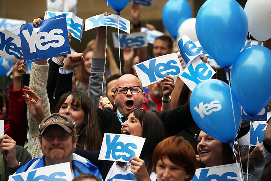 People react during a pro Scottish independence campaign rally, in central Glasgow, Scotland,Wednesday, Sept. 17, 2014. The two sides in Scotland's independence debate are scrambling to convert undecided voters, with just one day to go until a referendum on separation. (AP Photo/David Cheskin)